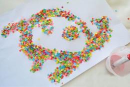 儿童创意手工画图片教程 幼儿园手工画图片教程 简单用打孔器制作的五彩画