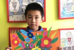 一盆鲜花儿童拼贴手工画图片 花盆和鲜花的剪纸粘贴手工画示例图片